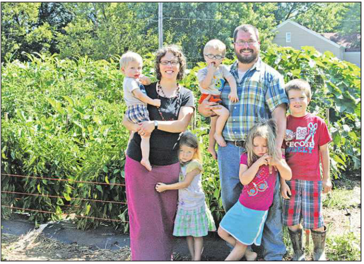 Jon and Sarah Baxa, and their children Benedict, 8, Scholastica, 6, Faustina, 4, twins Isidore and Ignatius, 20 months raise a garden at 1105 27th Street, Belleville. The share the produce with through an honor market, which allows customers to stop by any time, choose and weigh the vegetables they would like, and leave money in a locked box.