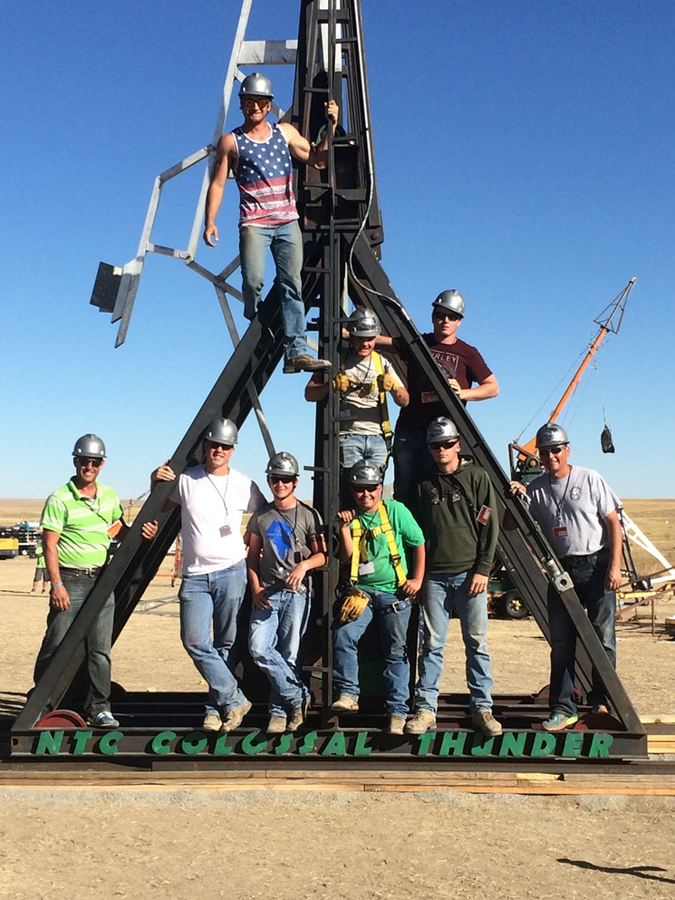 Team Colossal Thunder's impressive punkin chunkin' rig won this year's trebuchet division, shattering a world record in the process.